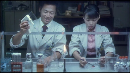 Toshiaki and Asakura are doing some scientific things, with lots of specialist equipment. There is a Bunsen burner in the middle of the frame