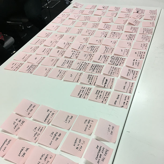 pink sticky notes neatly layed out on a table