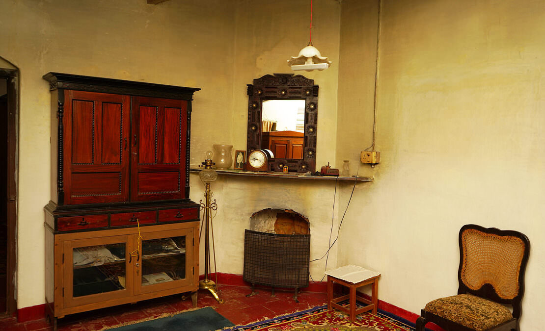 A bedroom fireplace in the corner