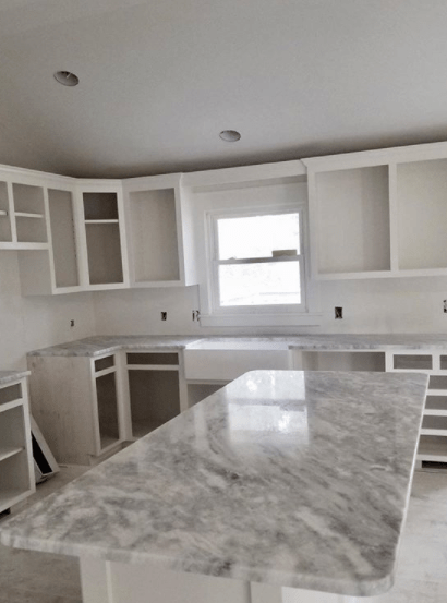 A marble kitchen countertop and island fabricated using donna sanda marble