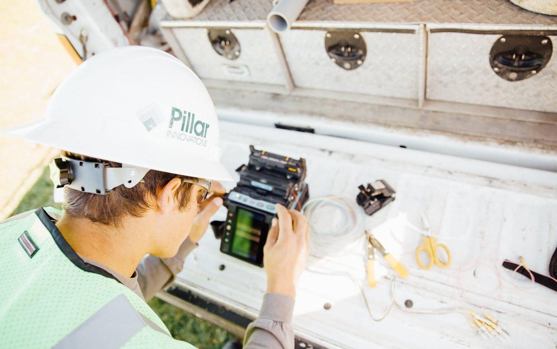 Pillar Innovations - Man working on electronics.