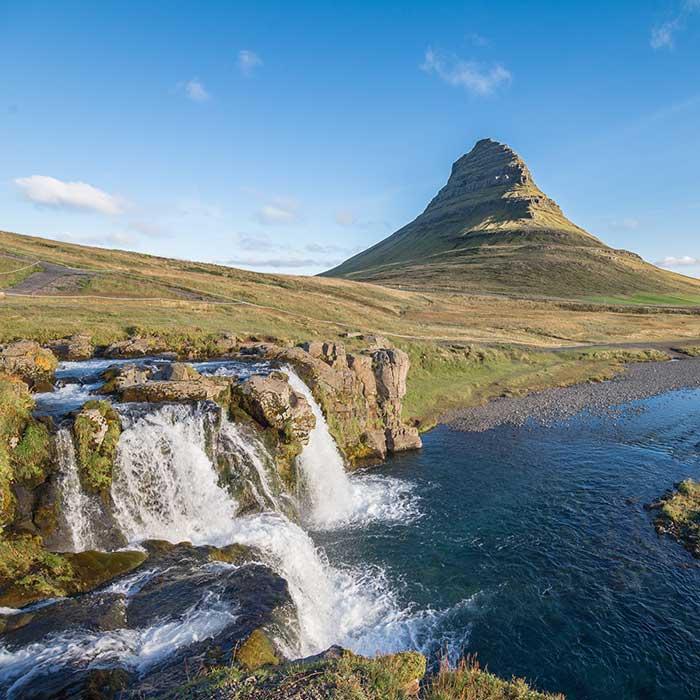 Kirkjufell towering over Kirkjufellsfoss, Iceland