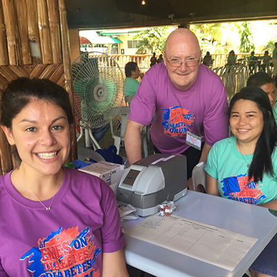 Lena Rennick & Neil Donelan pictured with the Point of Care (portable) system as part of humanitarian aid by the Fiona Kwok Diabetes Screening Program of Insulin for Life in a youth diabetes camp in the Philippines.