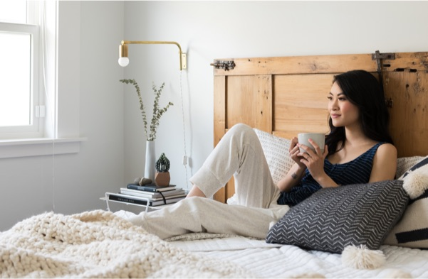 Women drinking coffee in bed