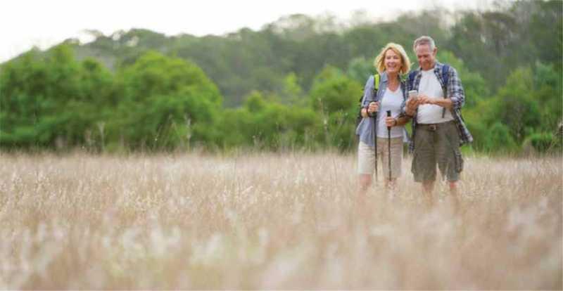 Hikers hiking with polls in Saskatchewan Grasslands