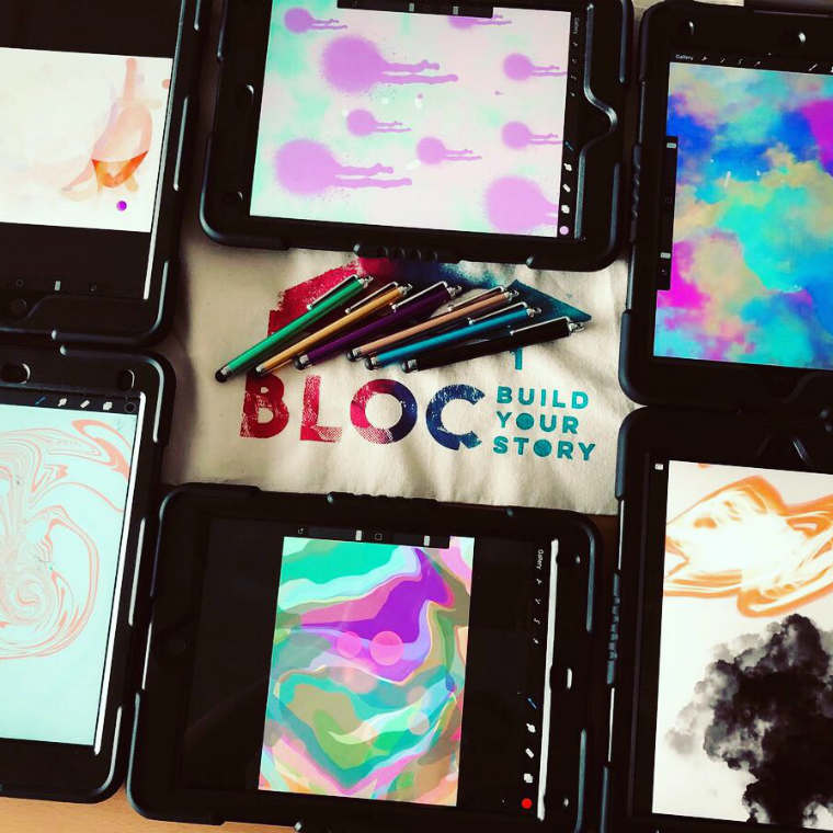 Colourful artworks on iPads surrounding the BLOC logo and some styluses