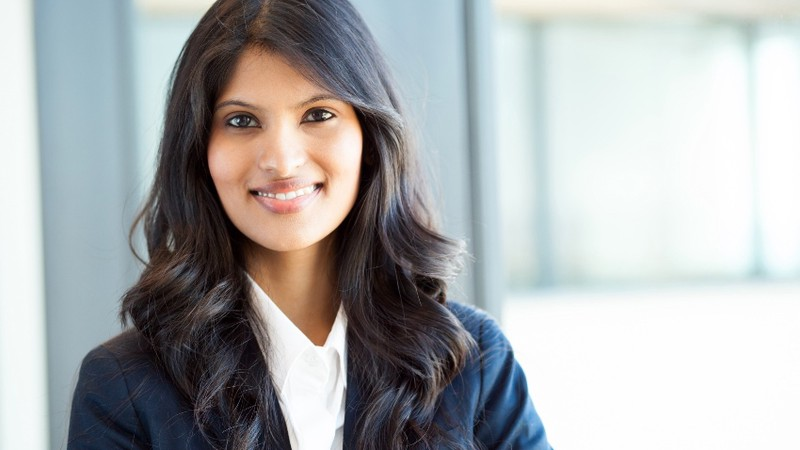 Photograph of an online MBA student in a business suit