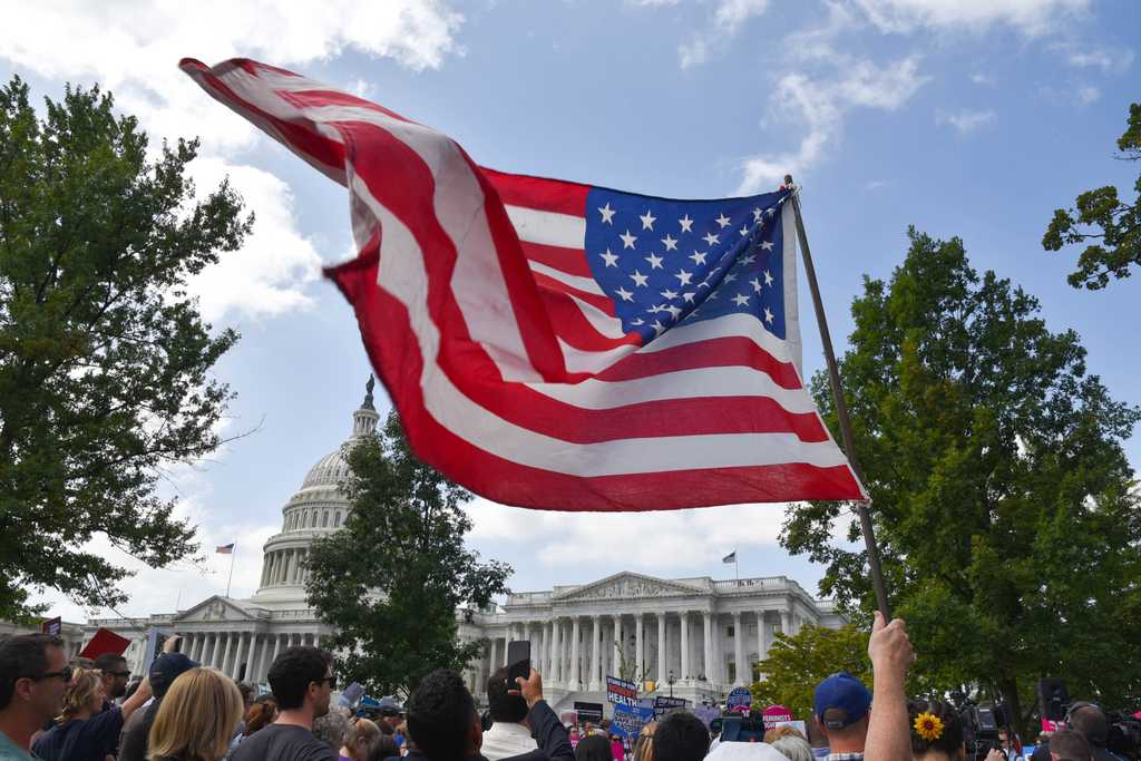 A protester waves an American flag in the breeze outside the U.S. Capitol