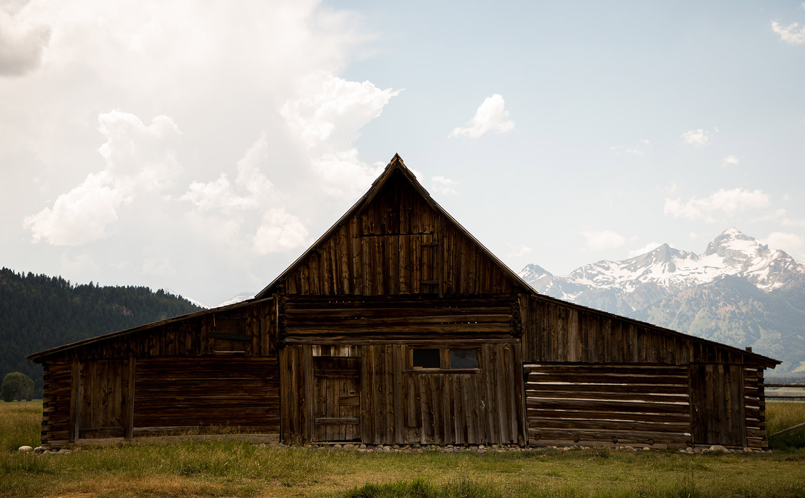 abandoned barn in front of mountains