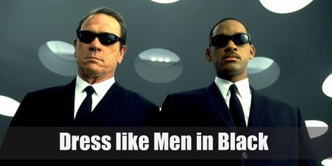 Agent J and Agent K wear identical outfits as this is the standard uniform of the Men in Black, the organization they belong in. They both wear a white dress shirt, a plain black tie, and a black suit while carrying weapons such as futuristic guns and etcetera.