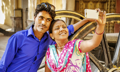 An ethnic couple taking a selfie