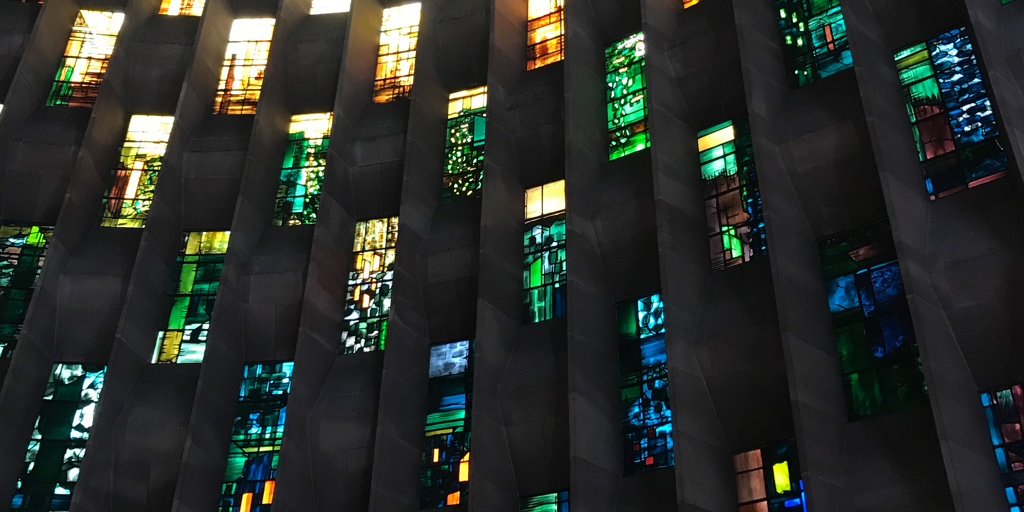 Colourful stained glass windows at Coventry cathedral.