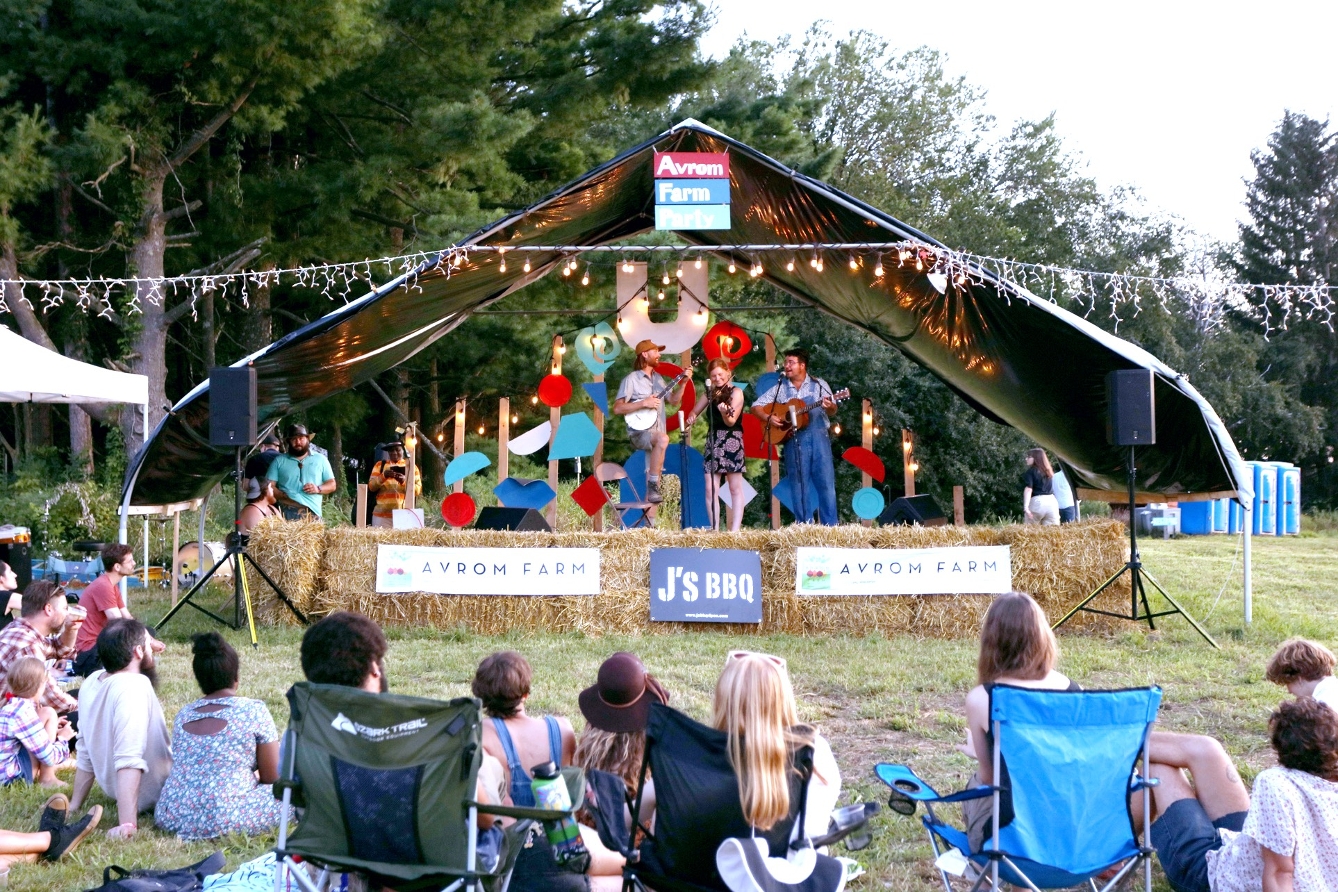 The musical group Jenny and the Hog Drovers on the Avrom Farm Party stage.