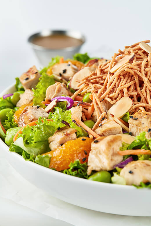 Asian-inspired Chinese Chicken salad piled with grilled chicken and dressed with soy-lime vinaigrette.