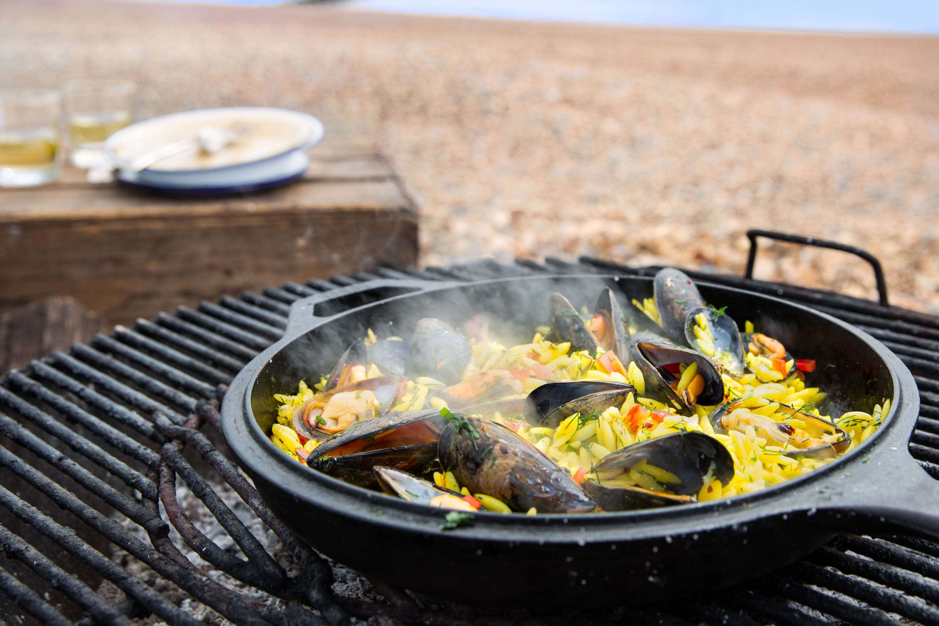 paella-cooking-on-the-bbq-on-the-beach