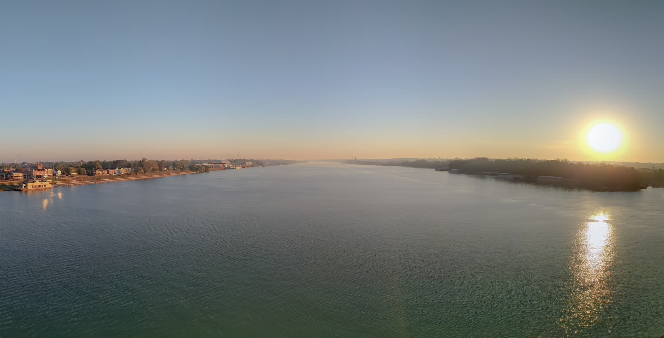 A panorama taken near the center of the Ohio River looking east, just after dawn. The left shore is Indiana, while the right shore is Kentucky.