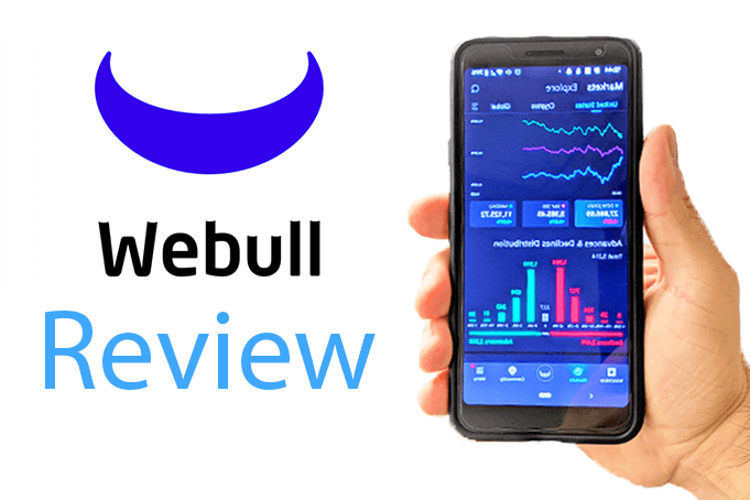 A hand holding a phone showing the WeBull investment app