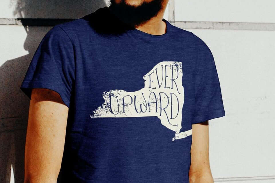 Man wearing New York State Motto navy blue tee shirt