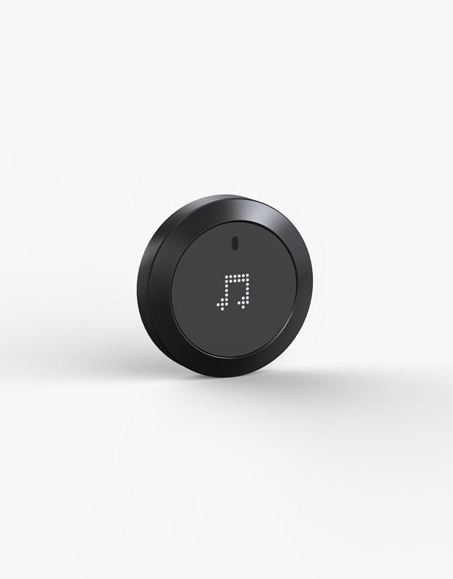 Nuimo Control Black from the frontside with a musical note on the display