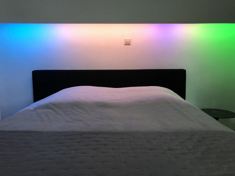 A LED strip above my bed showing different segments, bounded by colors