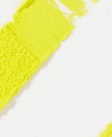 Tretinoin - Light gray backdrop with yellow powder shaped in a rectangular line angled at 45 degrees