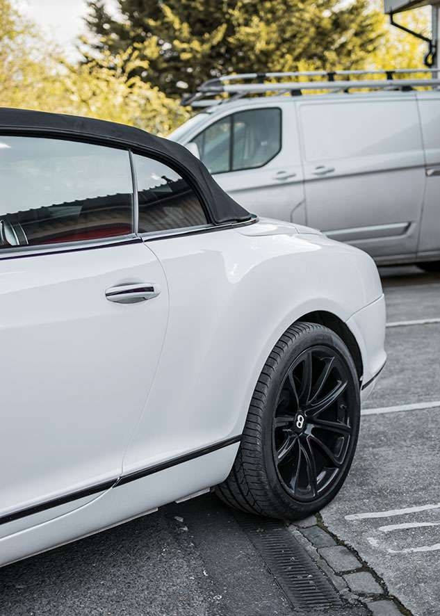 Bentley Continental GT car with tinted windows from side