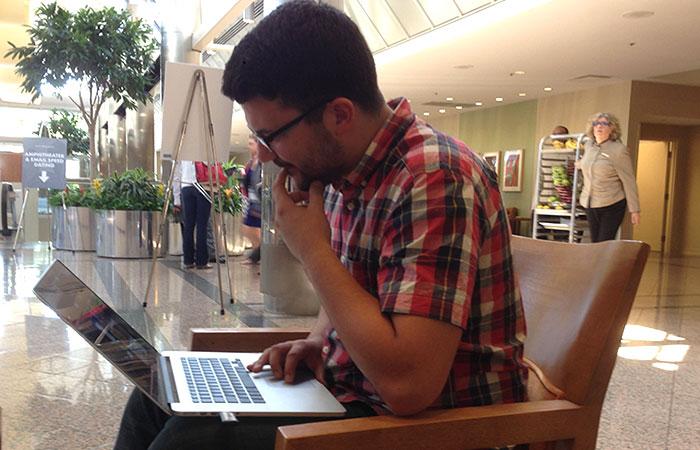Alex Ilhan on a laptop.