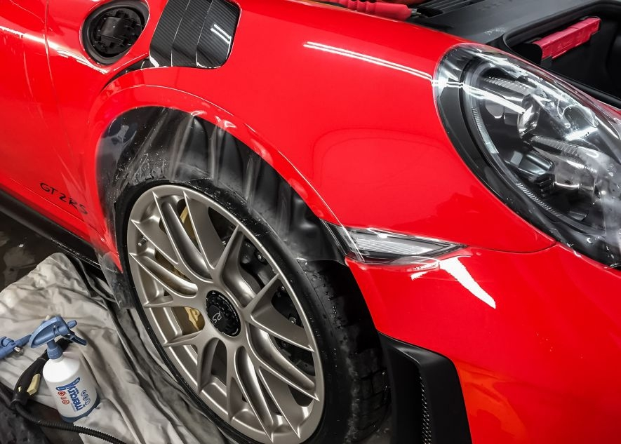 Paint protection film application on Porsche 911 GT2RS red car