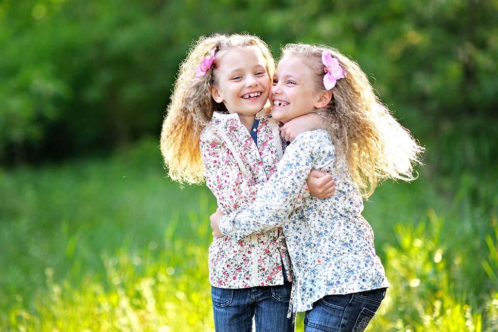 Portrait of two little girl twins