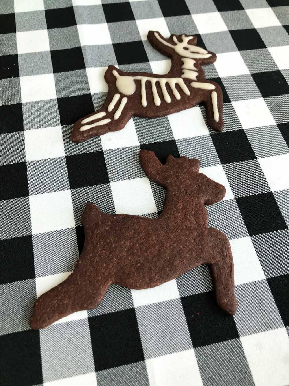 decorating vegan reindeer skeleton cookies