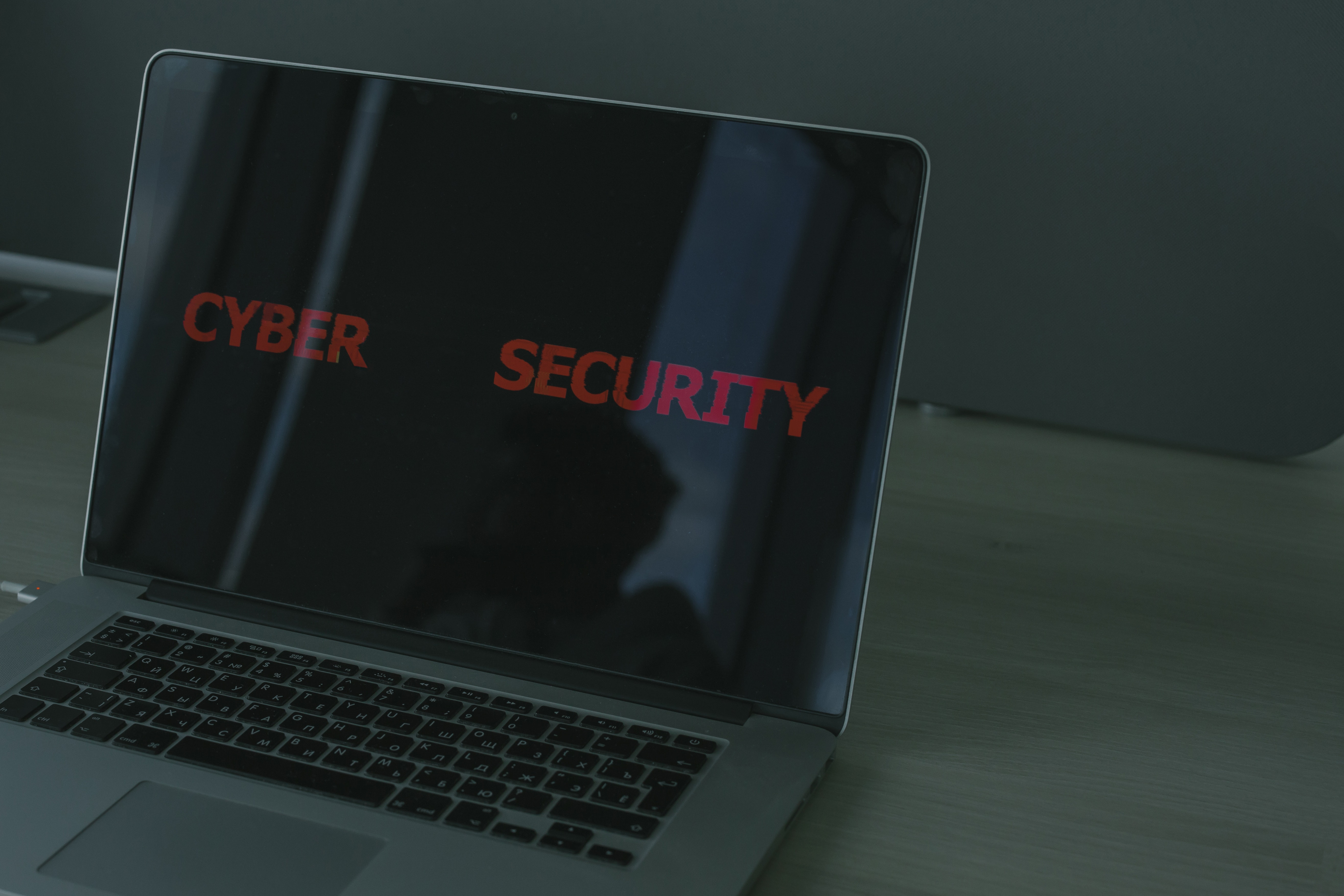 Laptop with the text cybersecurity on the screen