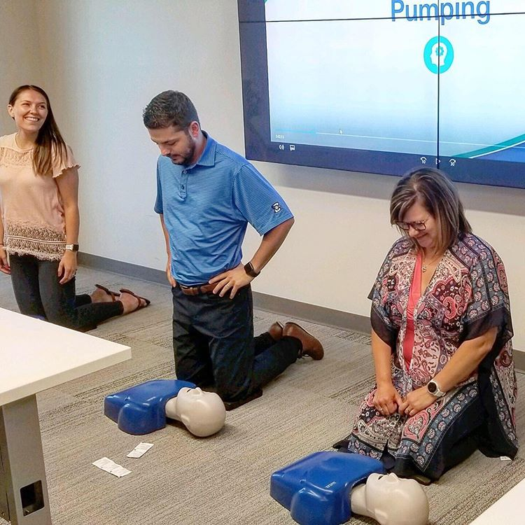 Employees engaging in CPR training