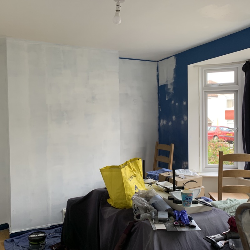 A partly painted room.