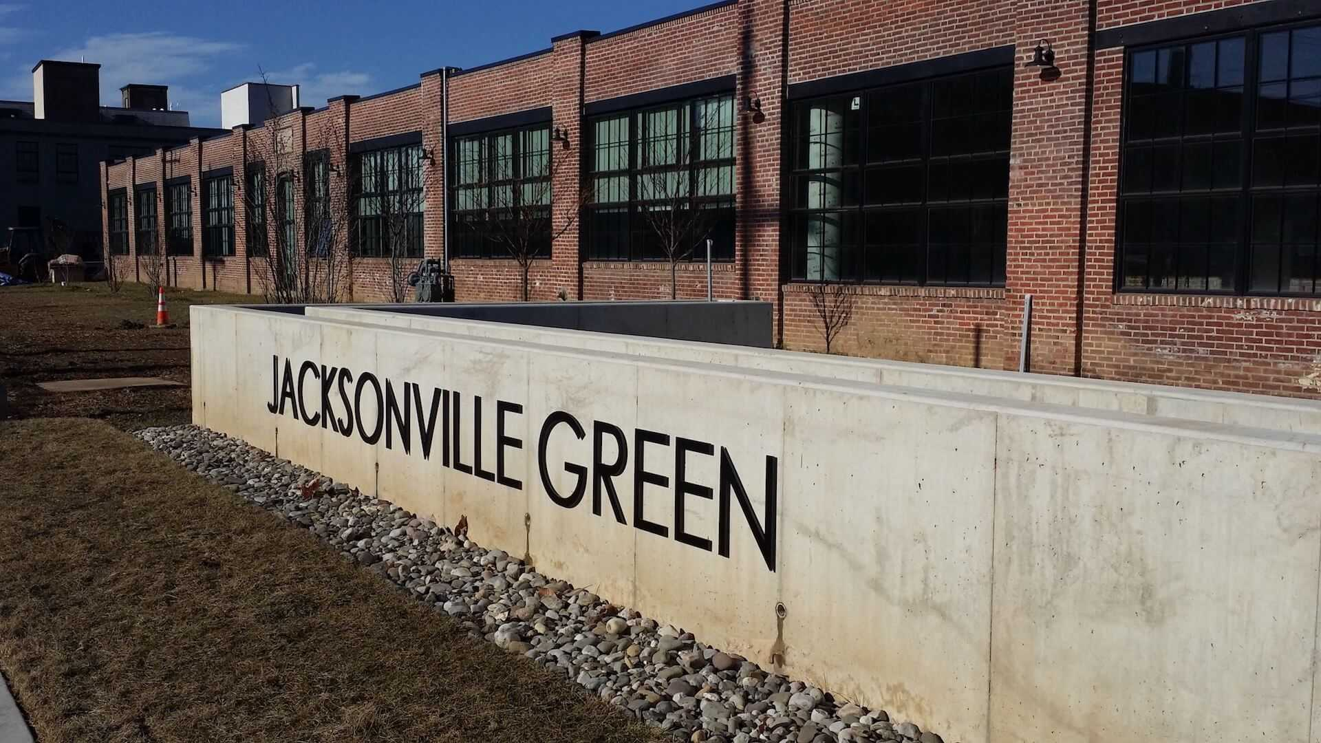 long concrete wall with Jacksonville Green on it