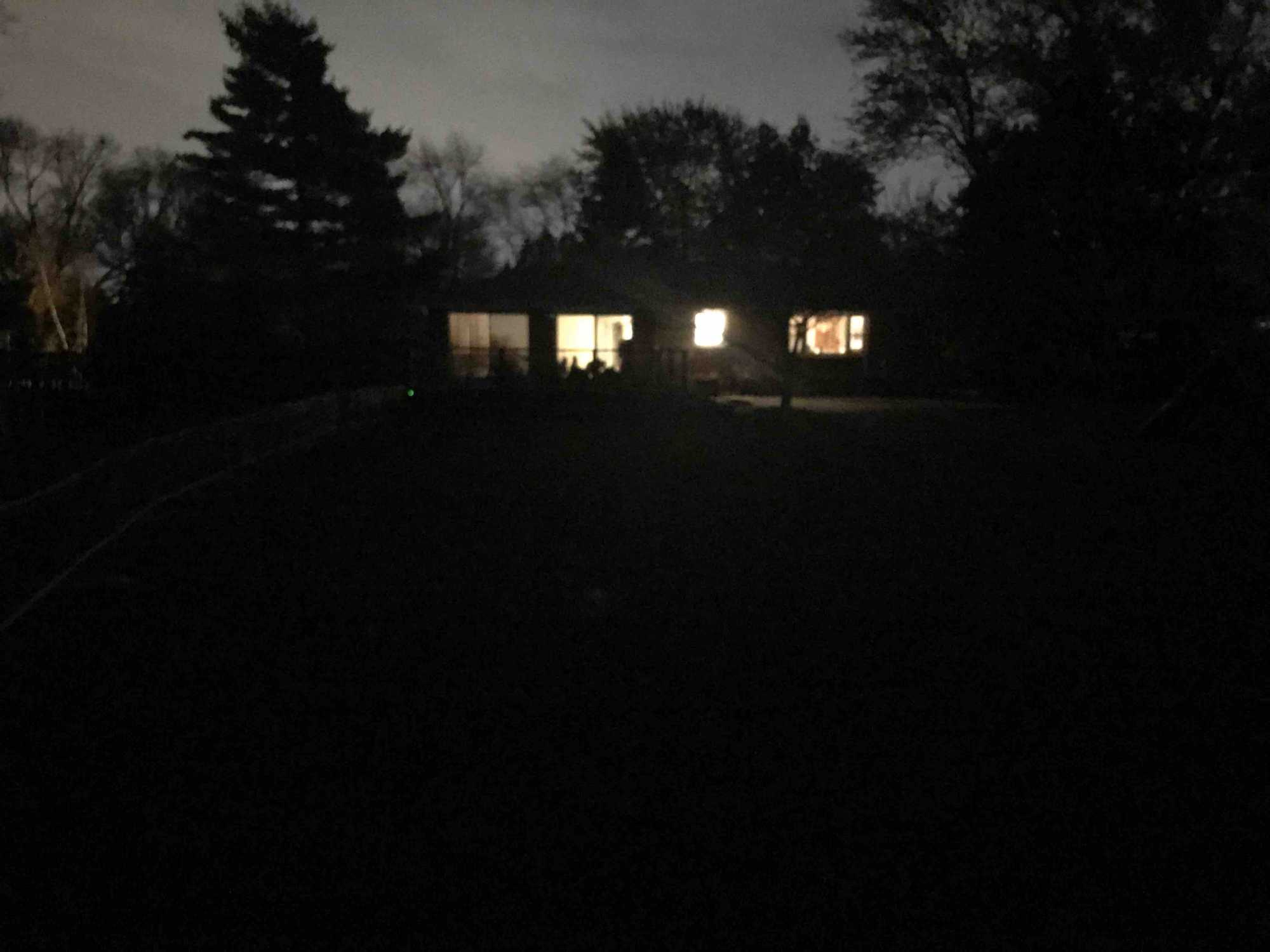 Dark yard with the house about 100ft away