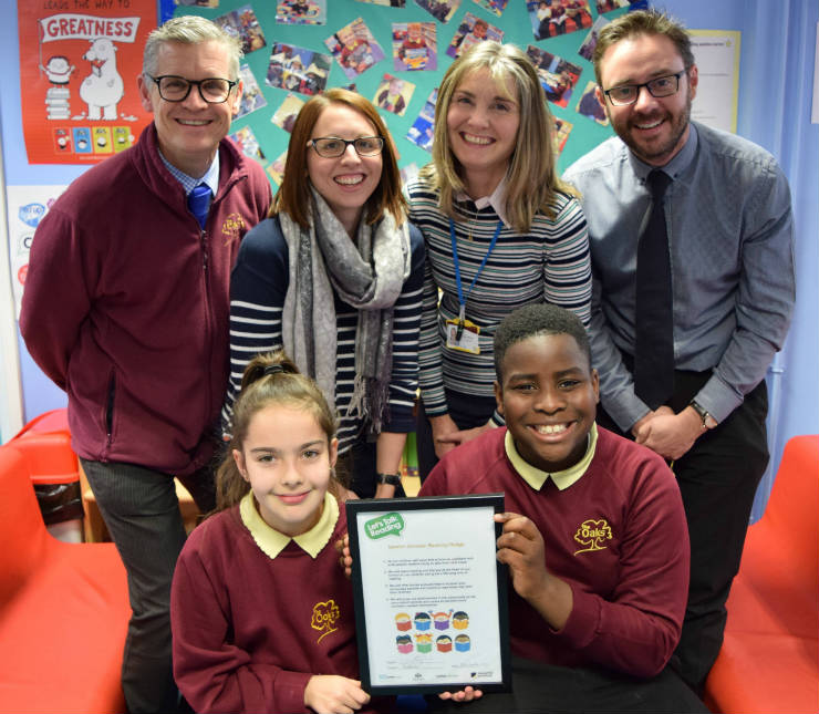 4 teachers and 2 pupils display a certificate