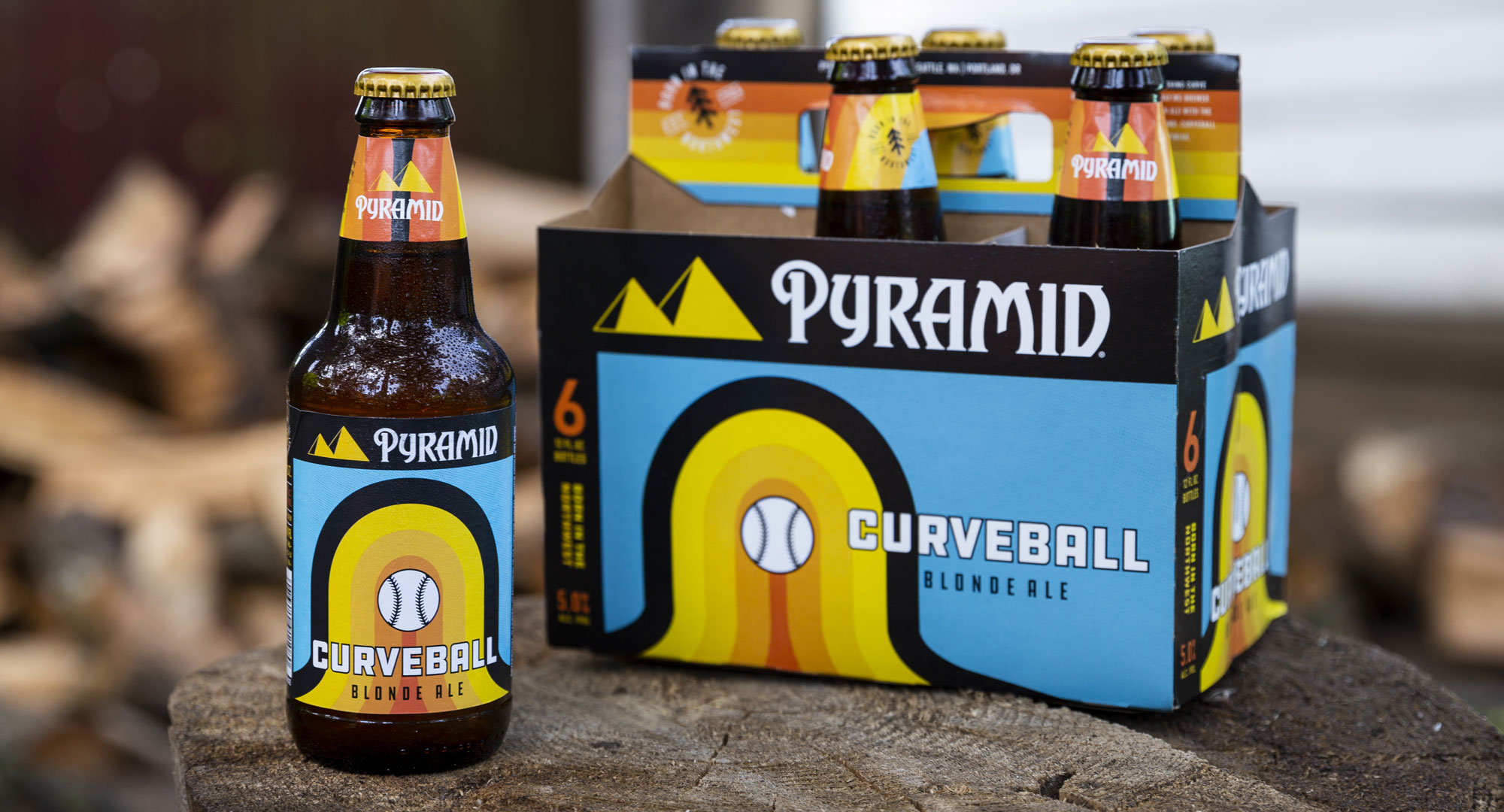 Curve Ball Bottle and 6-PAck on a stump
