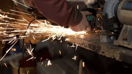 Man does construction and sparks fly whilst manufacturing #KPI