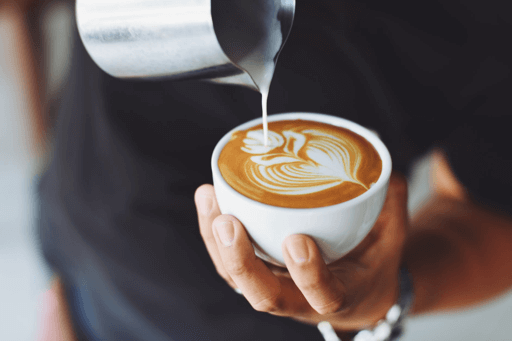 Someone making a cup of coffee