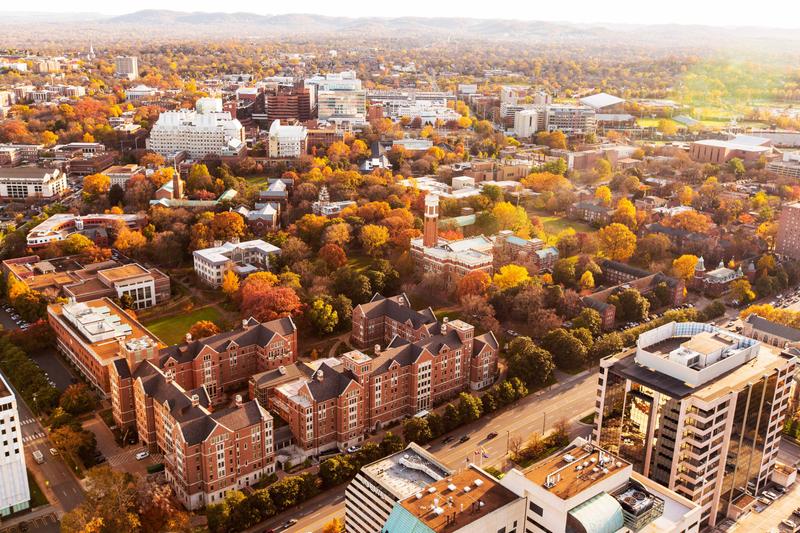 Aerial view of Vanderbilt campus buildings showing leaves turning autumn colors