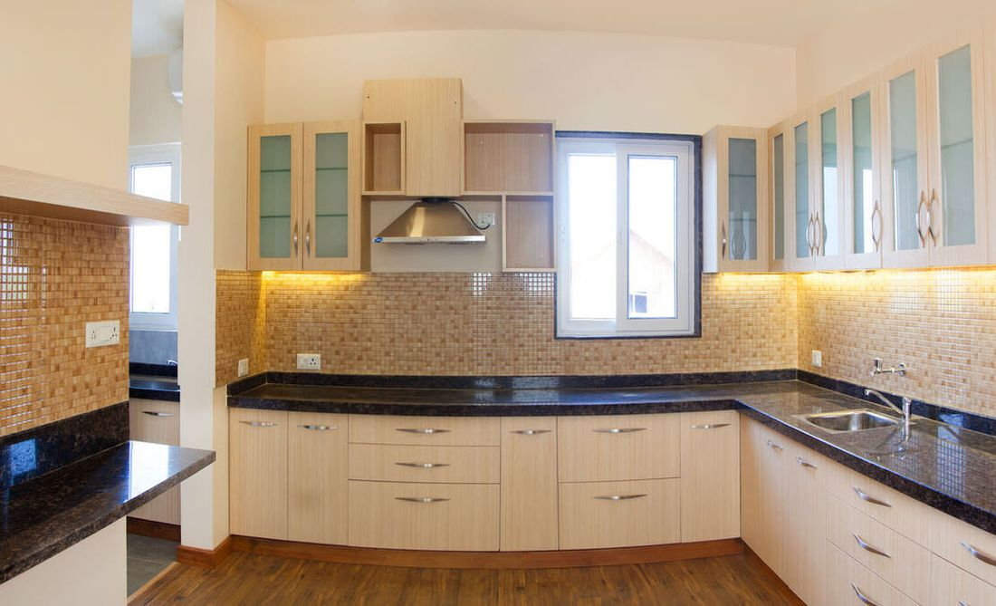 Wrap around kitchen with a breakfast table and counter lighting