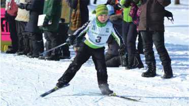Child skiing competitively