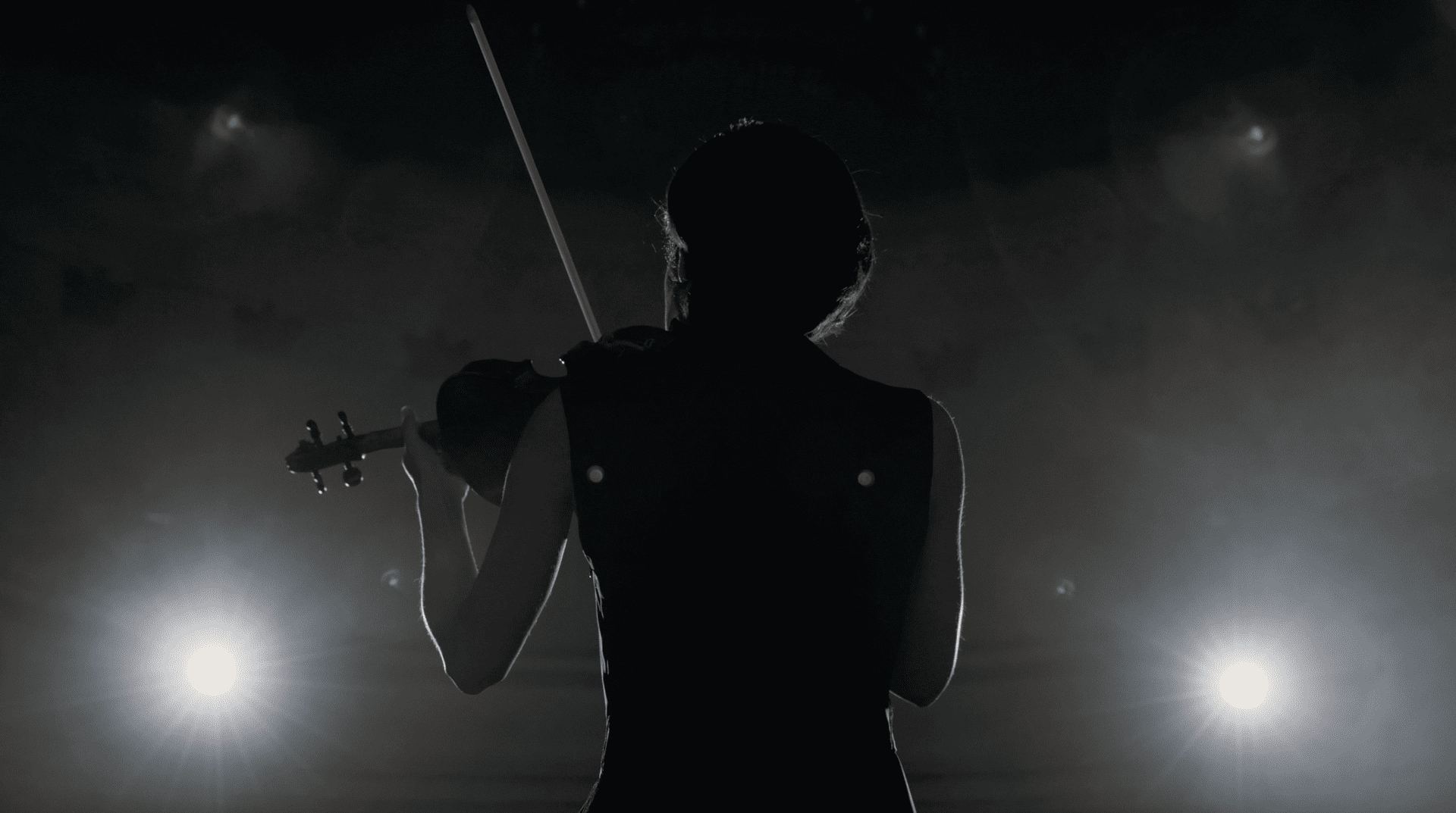 Violinist Performing on Stage with dramatic lighting