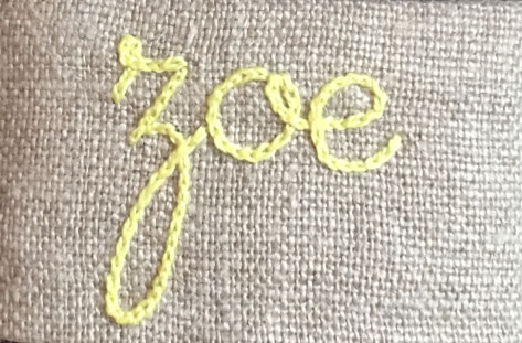 Broderie sur une serviette en tissu