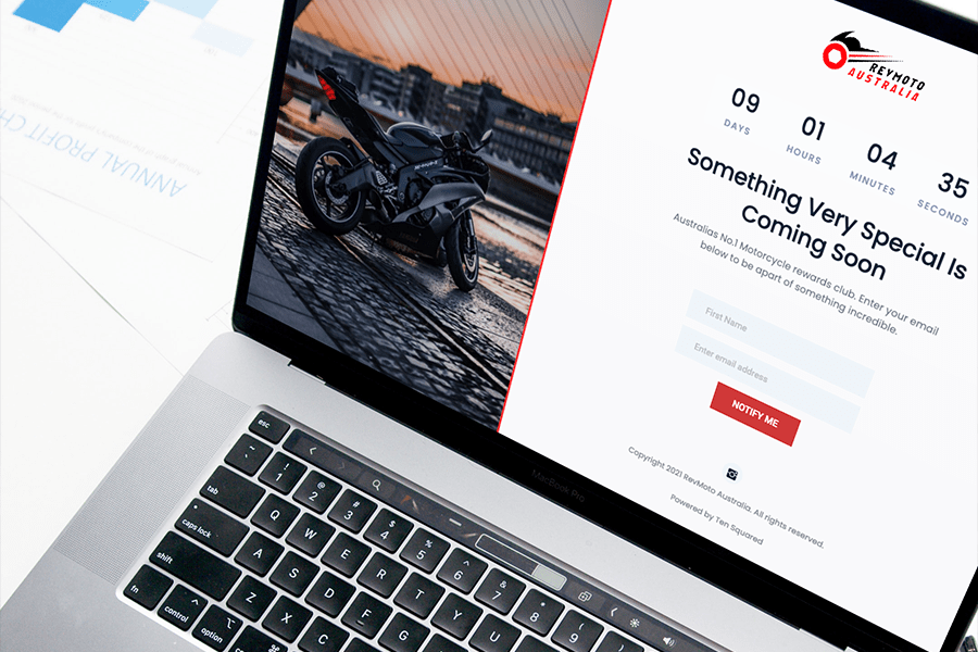 Revmoto Australia's coming soon page displayed on a macbook pro
