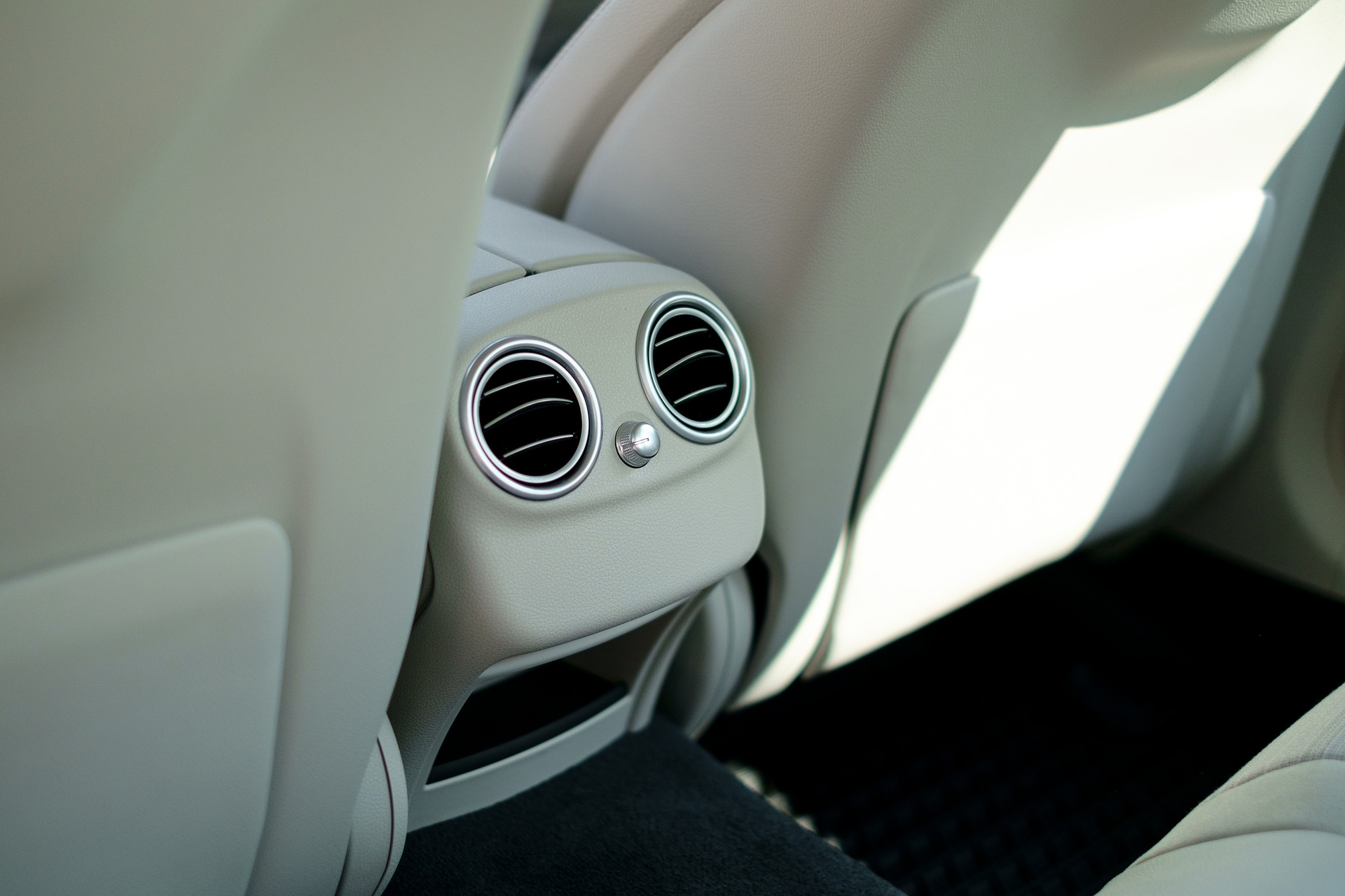 Light Gray Inerior of the Backseat of a Car and Air Conditioning Vents