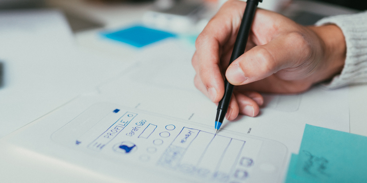 UX designer creating wireframes by hand