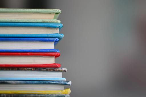 A stack of colourful books.