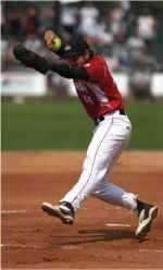 Baseball pitcher just before throwing a baseball