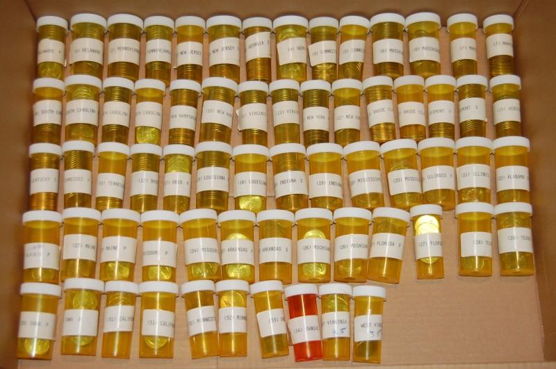 Quarters in pill bottles